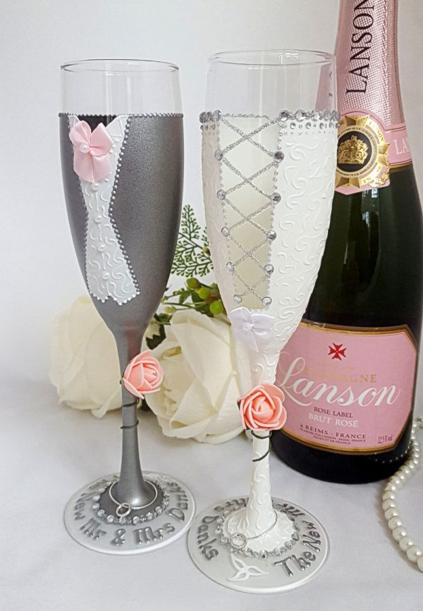 Hand painted bride and groom champagne flutes with diamante detail and personalised bases.