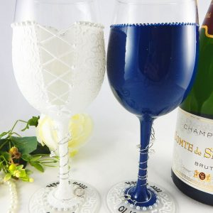 Hand painted and personalised wedding wine glasses with navy suit and names and wedding date on the bases.