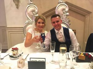 Happy couple toasting their big day with our champagne flutes