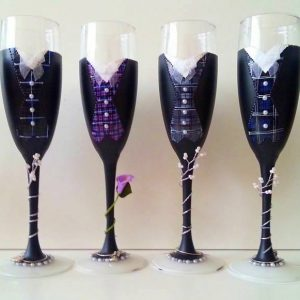 Several groom champagne flutes all ready and dressed up for their big days!