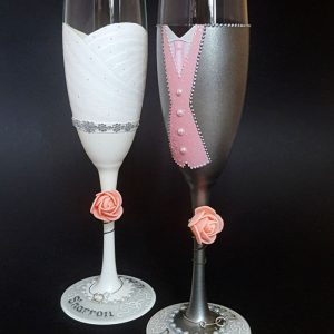 Blush pink wedding champagne flutes with pink waistcoat and bespoke wedding dress.
