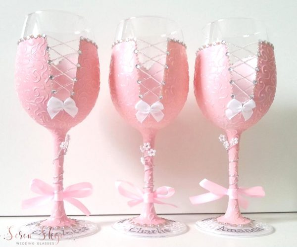 Blush pink bridesmaids wine glasses, hand painted and personalised with names on the bases.