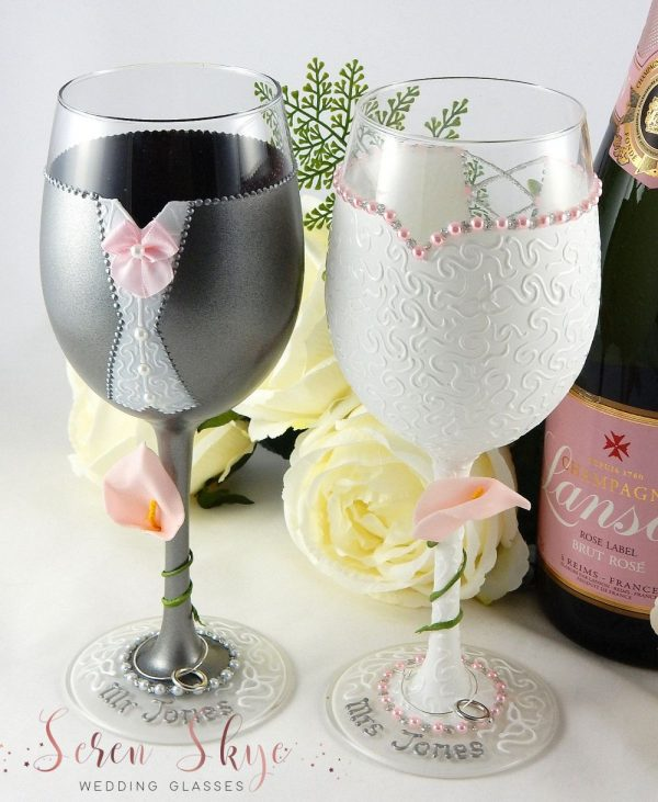 Hand painted personalised wedding wine glasses for a blush pink colour scheme.