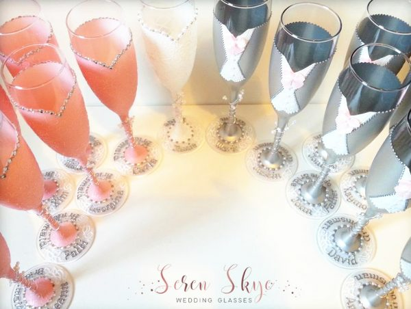 Set of hand painted and personalised champagne glasses for a blush pink colour scheme. Thank you gifts for everyone in the bridal party.