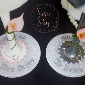 Personalised wedding wine glasses bases with calia lilies and silver writing.