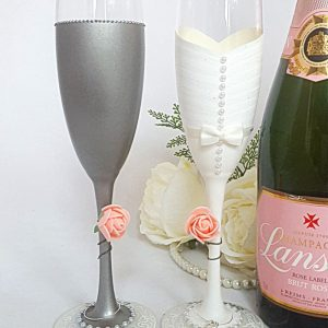 Custom made bride champagne flute with buttons down the back and blush pink colour scheme.