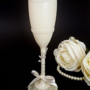 Bespoke bride champagne glass with pearl detail and silver writing on the base.
