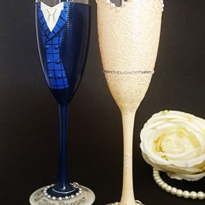 Custom made wedding champagne flutes with tartan waistcoat and bespoke ivory lace wedding dress.