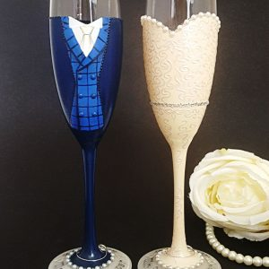 Bespoke brideand groom champagne glasses with blue tartan double breasted waistcoat and wedding dress with sweetheart neckline and diamante belt.