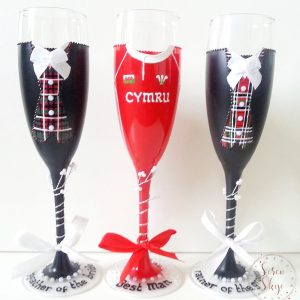 Bespoke groomsmen champagne flutes with tartan waistcoats and Welsh rugby shirt.