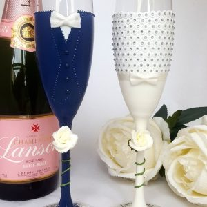 Custom made Catherine Parry bride champagne glass with ivory roses.