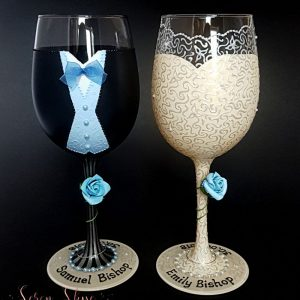 Bespoke wedding wine glasses with pinstripe trousers and baby blue colour scheme.