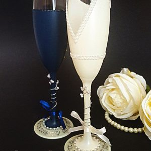 Custom made wedding champagne flutes to match ivory wedding dress.
