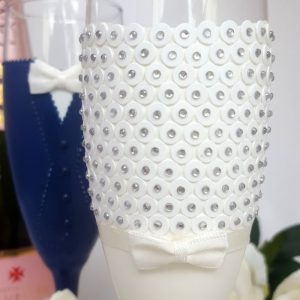 Bespoke champagne flutes with a Catherine Parry wedding dress.