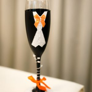 Best man champagne flute with black suit, orange bow tie and personalised with name on the base.