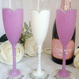Bride and bridesmaids champagne glasses for a lavender colour scheme.