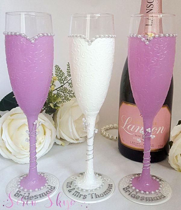 Bride and bridesmaids champagne glasses for a lavender colour scheme.
