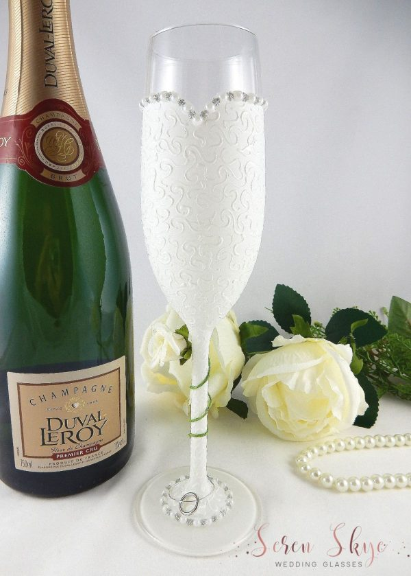 Bride champagne flute gift with ivory rose winding around the stem.
