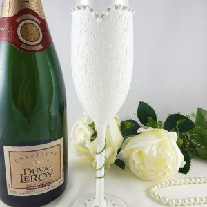 Personalised bride champagne glass with ivory rose winding around the stem.