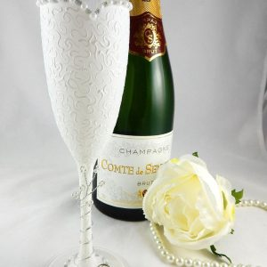 Bride champagne flute with sweetheart neckline and textured pattern.