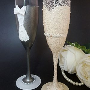Bride and groom champagne flutes with beautiful lce design and keyhole back.