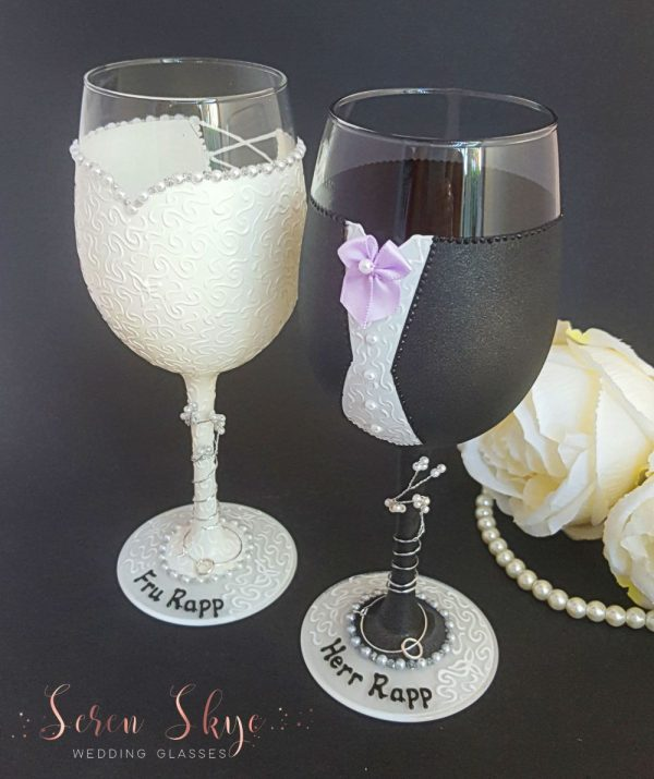 Hand painted wedding wine glasses for a lilac colour scheme.