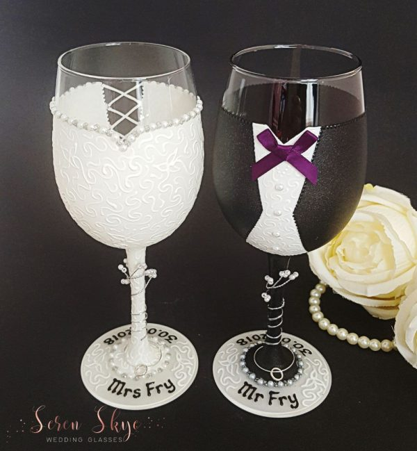 Wedding glasses with dark grey jacket and plum bow tie.