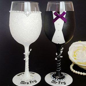 Bride and groom wine glasses with charcoal jacket and purple bow tie, personalised in black writing.