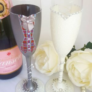 Scottish wedding gift personalised champagne glasses with tartan waistcoat and grey suit.