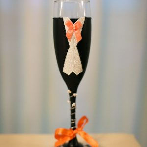 Father of the bride champagne flute gift with orange bow tie.