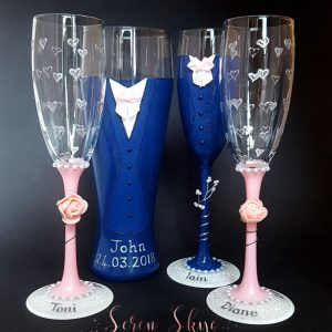 Set of bridal party champagne flutes and pint glass for a blush pink themed wedding.