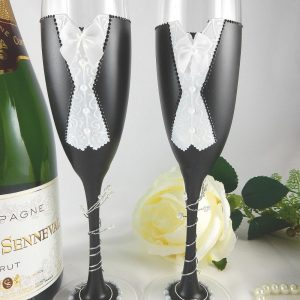 Black and white same sex wedding champagne glasses.