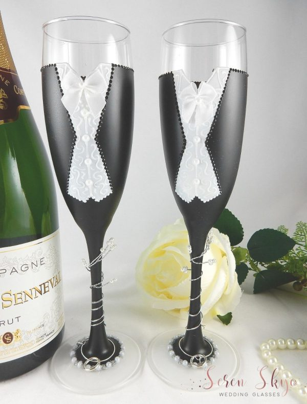 Black and white same sex wedding champagne glasses.