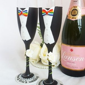 'His & His' matching champagne flutes same sex marriage gift personalised with names.