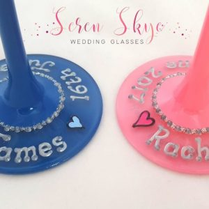 The bases of  pair of Mr & Mrs blue and pink personalised wedding champagne flutes.