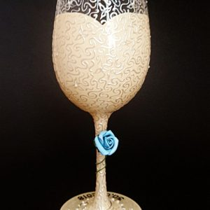Ivory lace wedding dress bride to be wine glass with blue rose.