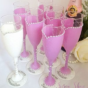 Set of bride and bridesmaids champagne flutes with free personalisation for any colour scheme.