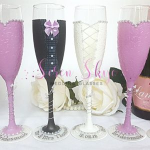 Champagne flutes for wedding thank you gifts with personalised bases and lavender colour scheme.