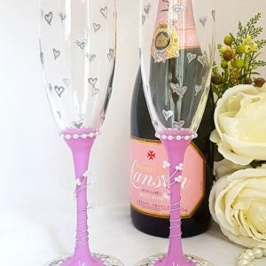 A pair of champagne flutes for mother of the bride and groom with little hearts and stems to match your colour scheme.