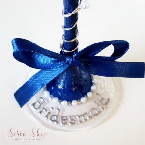 Personalised base of a navy bridesmaids champagne flute.