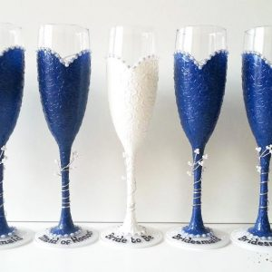 Navy personalised bridesmaids champagne flutes with names.