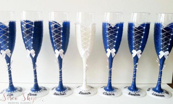 Bridesmaids thank you gift champagne flutes hand painted and personalised with names.
