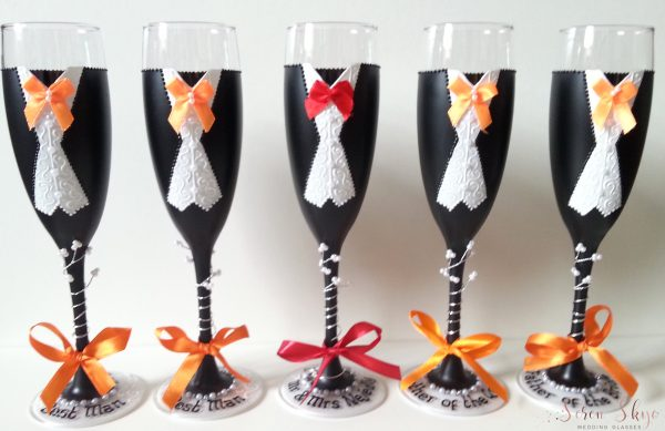 Hand painted personalised groomsmen champagne flutes for an Autumn wedding.