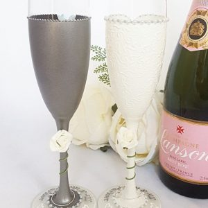 Ruby wedding gift champagne flutes with ivory roses.