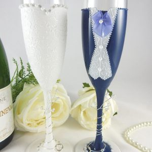 Wedding champagne flutes gift with navy suit and personalised on the bases.