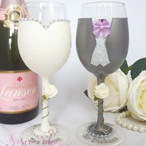 Hand painted wine glasses wedding gift with grey suit and lilac tie.