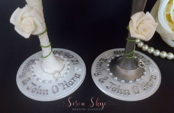 Personalised bases for bride and groom wedding wine glasses.