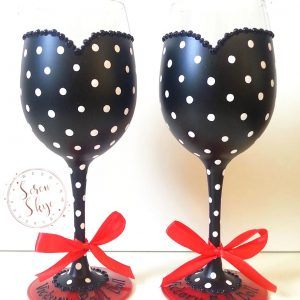 Hand painted polka dot personalised bridesmaids wine glasses.