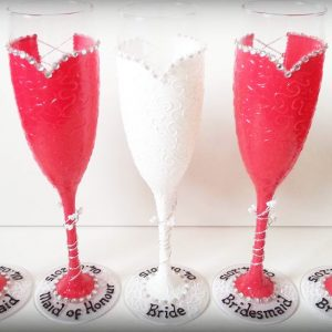 Red bridesmaids champagne glasses personalised with names.