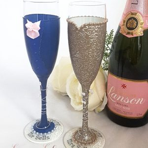 Beautiful gold and blush pink personalised champagne flutes wedding gift.